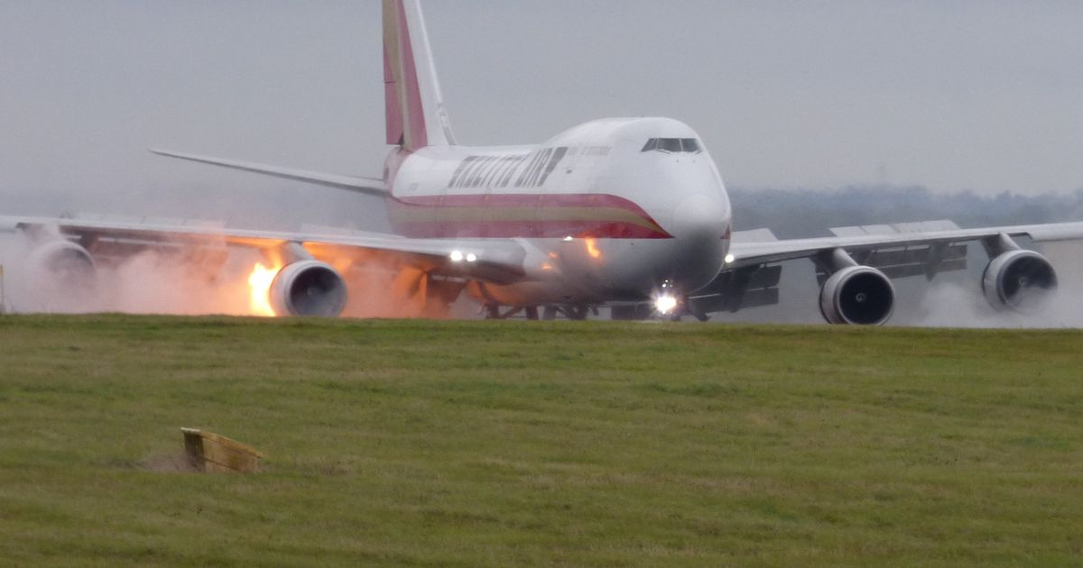 Plane catches fire as it comes in to land