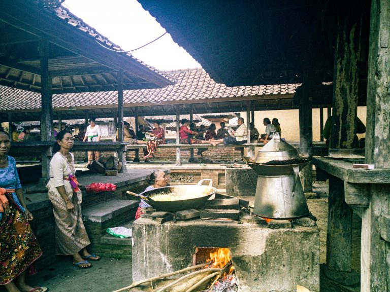 Things To Do in Amed & East Bali Tenganan Pegeringsingan Village women cooking and hand making the small cases for the offerings to Gods The Travel Deck