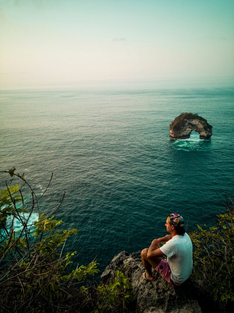 James looking at the view at Banah cliff over the cliffs and the arched rock