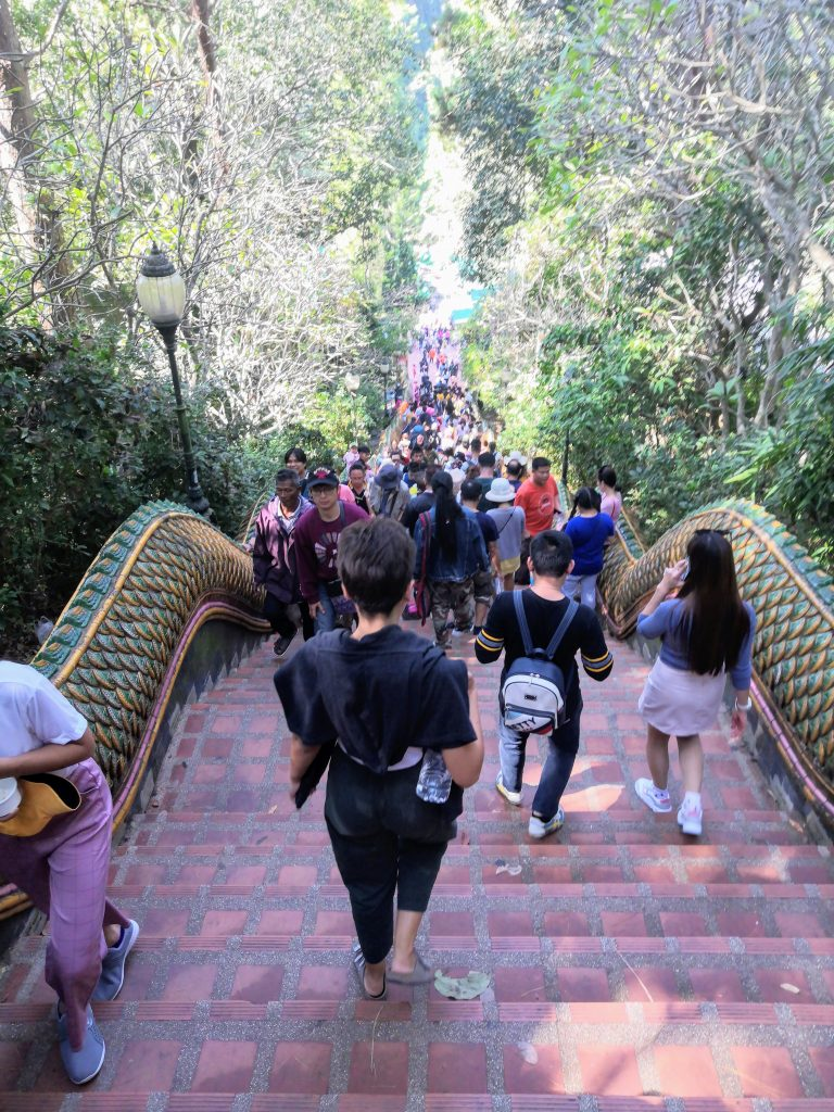 the stairs leading to Wat Doi Suthep packed with locals who head to the temple for new year