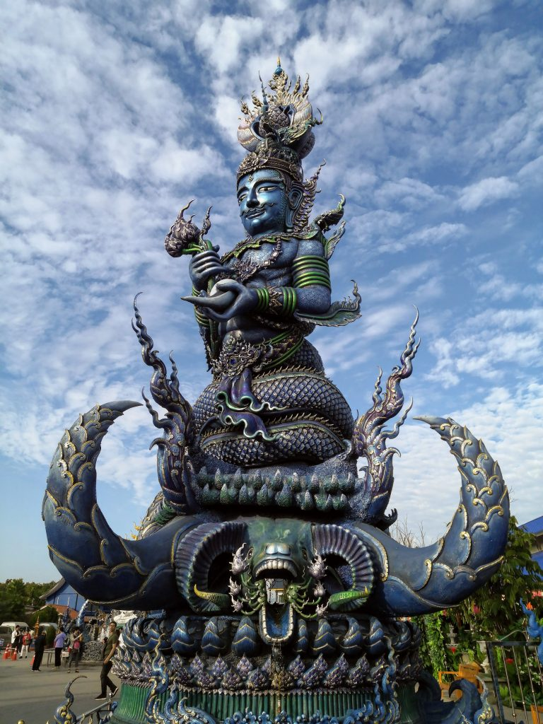 A huge blue statue at the entrance to Blue Temple in Chaing Rai
