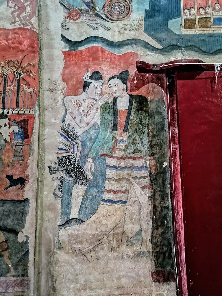 the famous mural in Wat Phumin of a man whispering to the ear of a woman