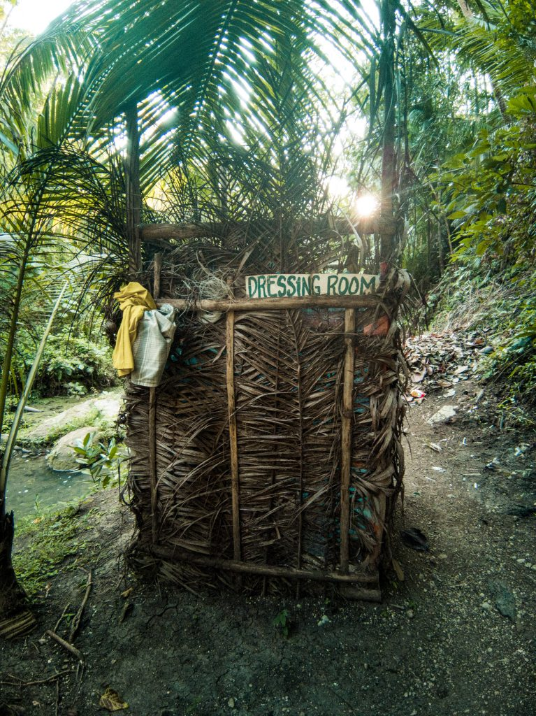 A makeshift Filipino changing room made of all kinds of materials