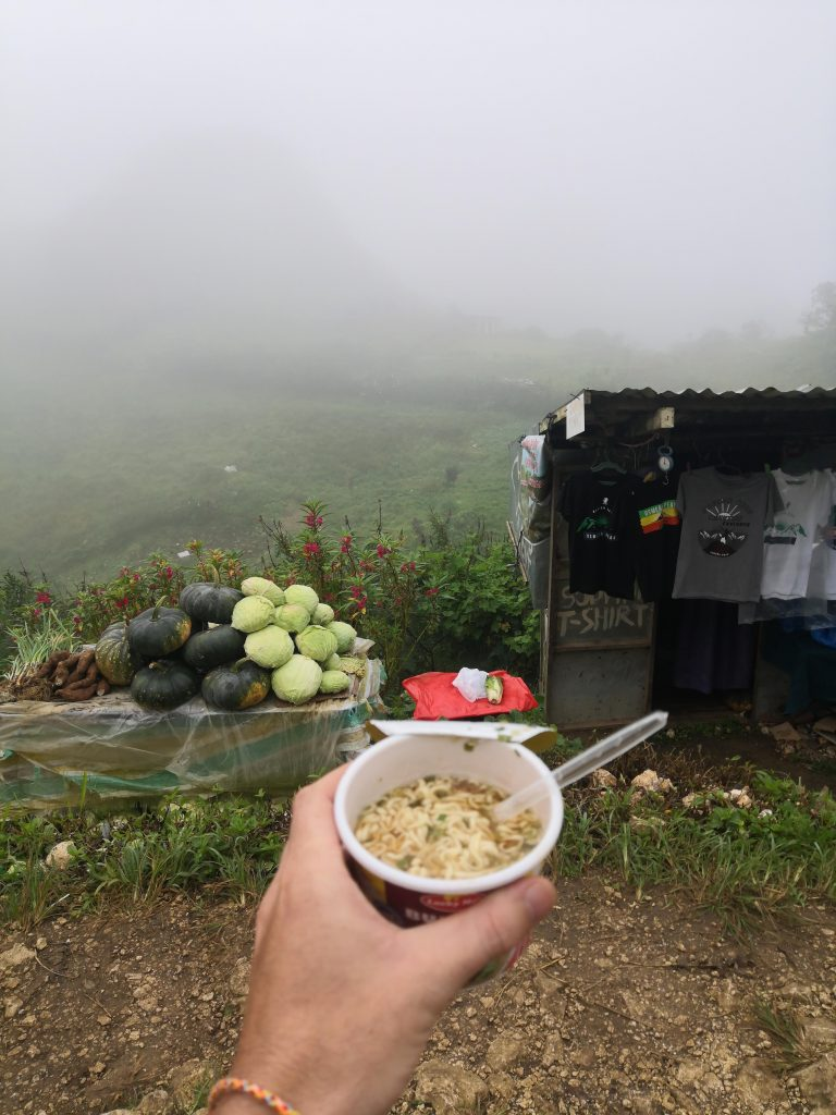 warming up with a cup of noodles near Osmena Peak
