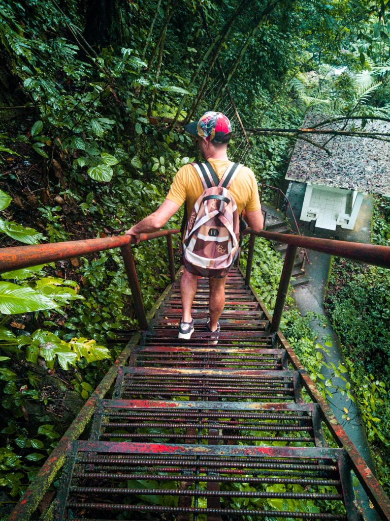 a flight of steel stairs that lead to the created by Casaroro Falls