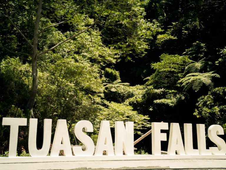 The big concrete sign indicating the direction to Tuasan Falls