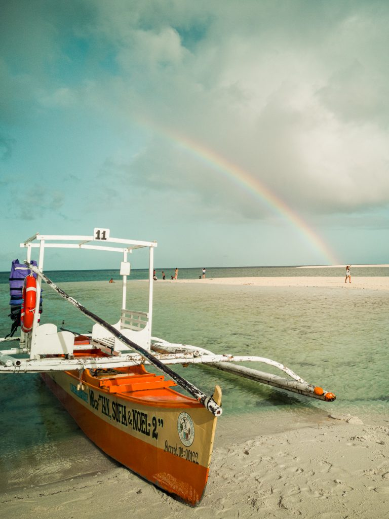 15 minutes after arriving on white island, it started raining. However, 5 minutes later the rain stopped and a beautiful rainbow formed right in front of us.