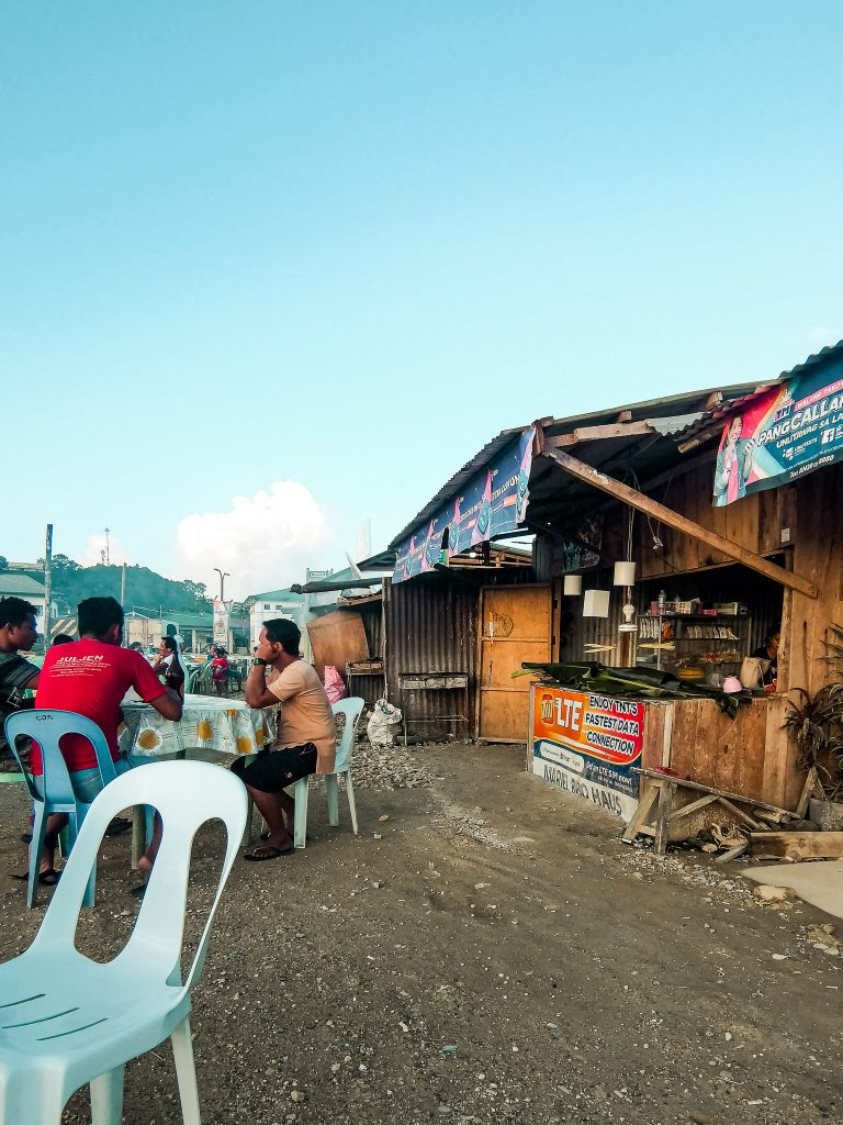 Dapa is a favourite hotspot with locals. Here a group of Filipinos enjoys a few beers at sunset