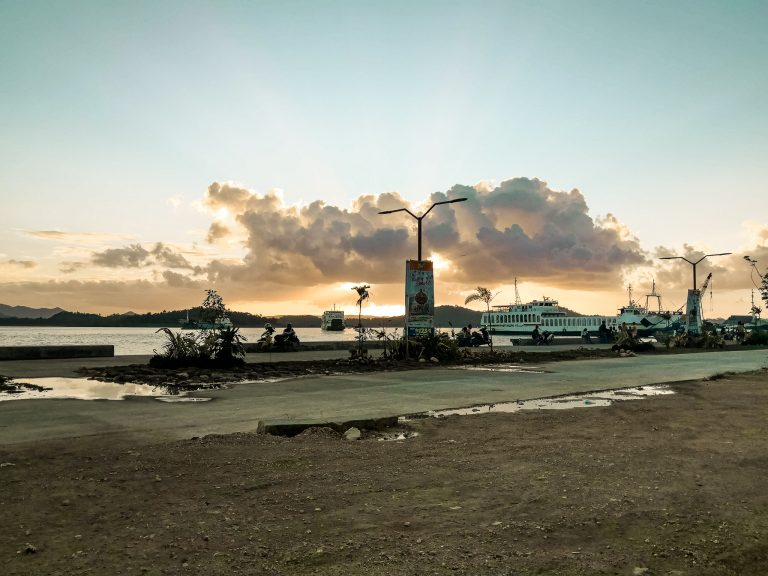 The sun slowly fading away behind the Siargao's ferry terminal in Dapa town