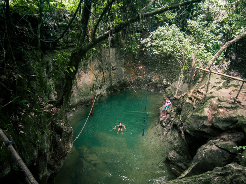 Tayangban pool which is like a miniature canyon amidst cliffs and tropical trees