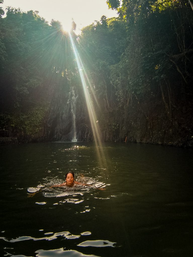 Jacqueline swimming in the chilly waters at Siargao Falls
