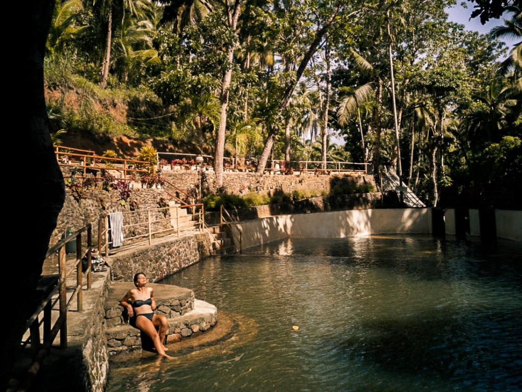 Jacqueline warming up after an early morning swim in the pool beneath Taktak Falls