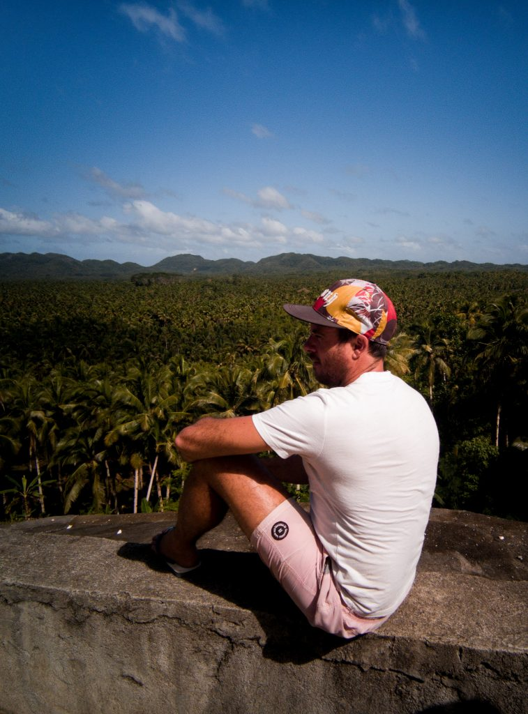 James sitting on the wall that separated him from this sea of coconut trees at the Coconut Trees View Deck Siargao