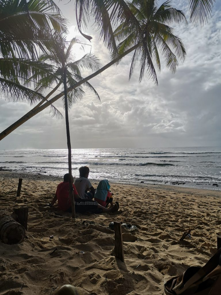 A group of local kids at secret beach in North Siargao