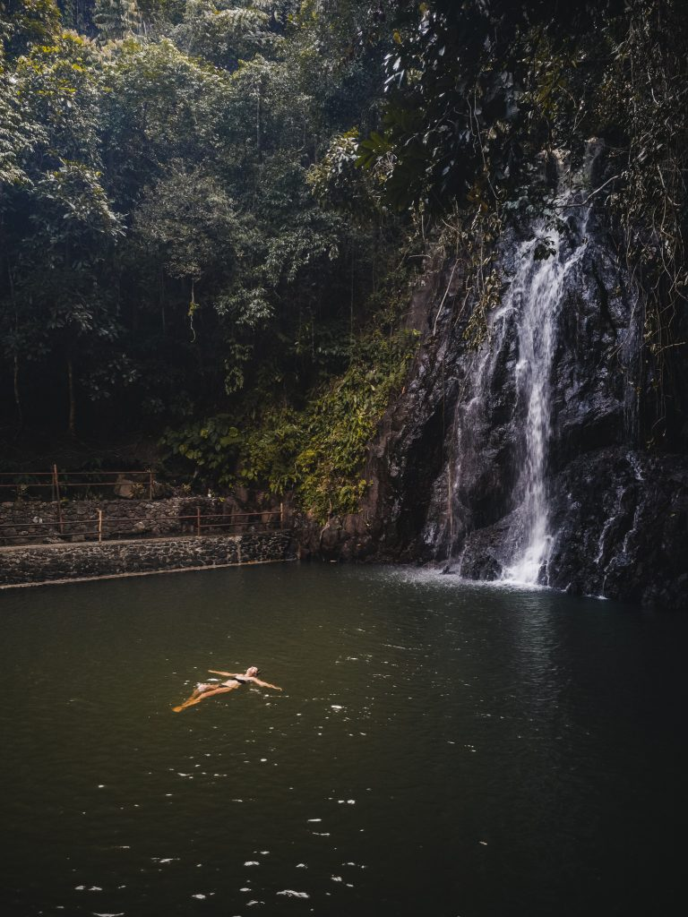 Jacqueline floating in the pool at Tak Tak Falls in North Siargao.