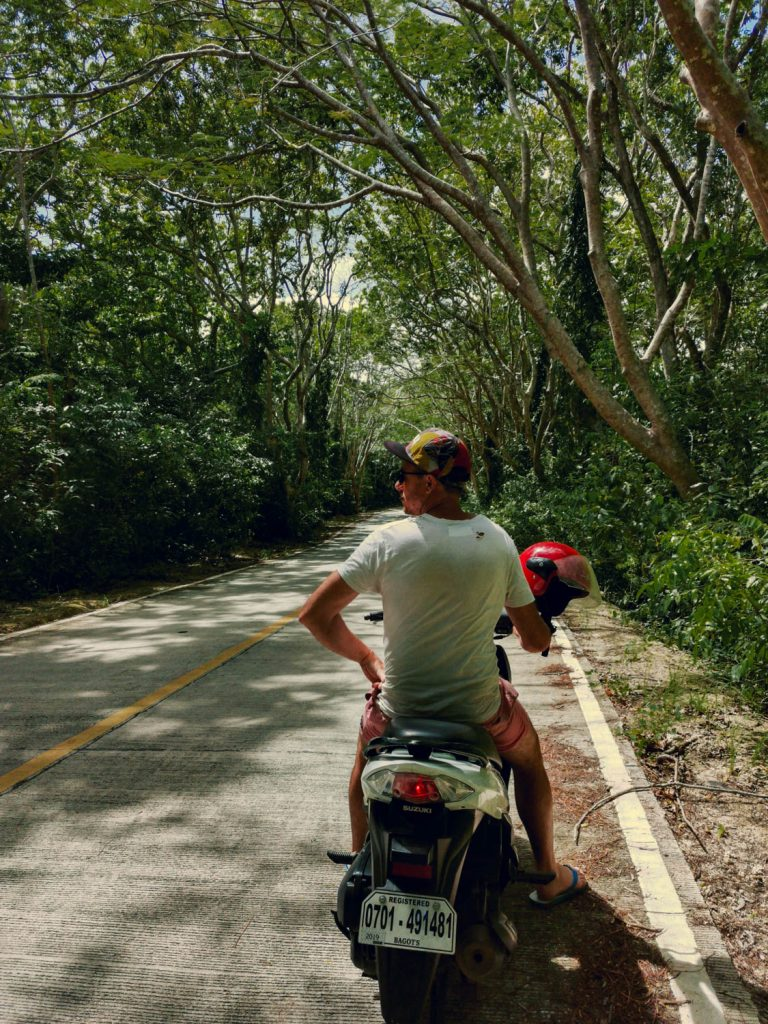 The scooter ride through forestry leading to Salagdoong beach is a highlight of the journey