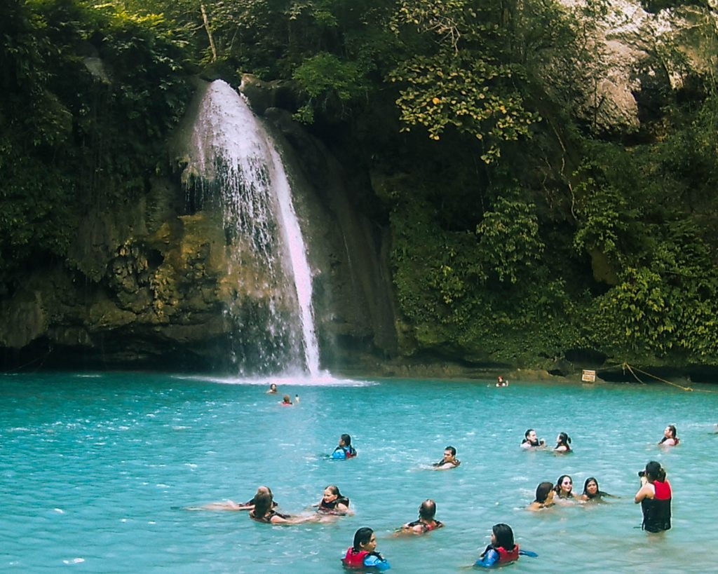 Kawasan waterfall plunging into a milky blue pool so bright we couldn't believe our eyes