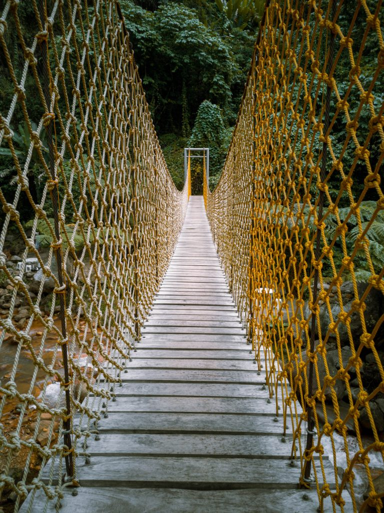 This is the wobbly rope bridge that crosses over a river and leads exactly beside the waterfall.