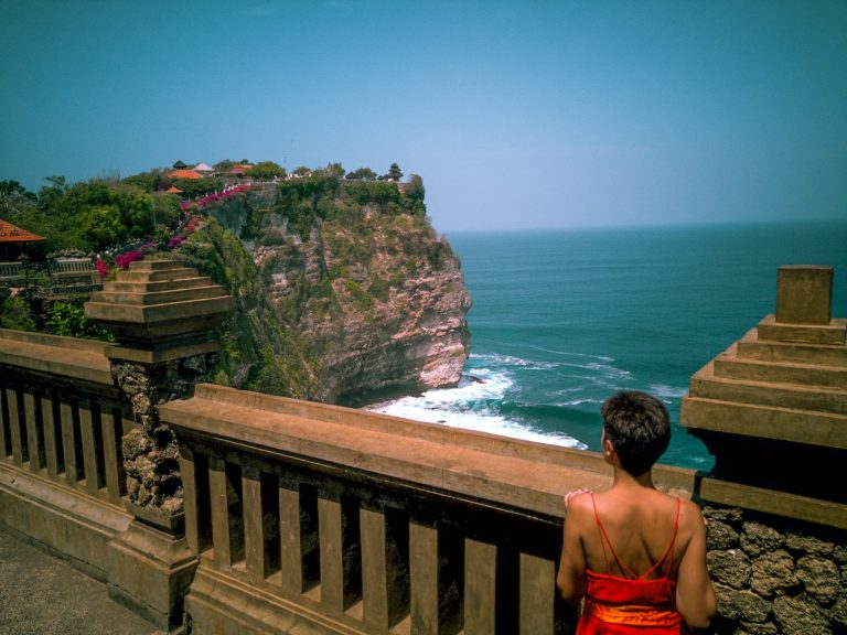 Jacqueline standing at a cliff temple in Uluwatu