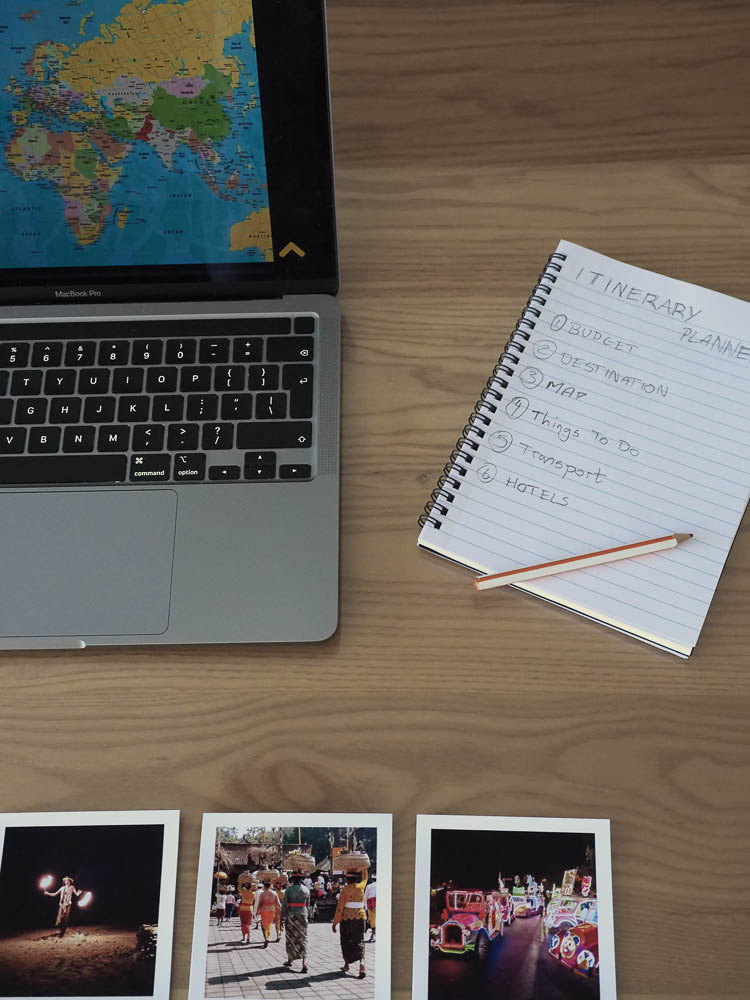 In this image I placed my notebook, pencil, and few polaroids of my last trip which help me decide where my next destination will be