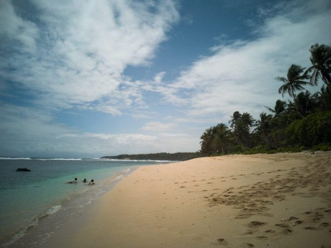 The long stretch of white sand and tropical trees at Pacifico beach
