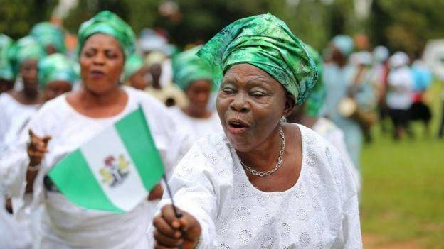 nigeria woman with national flag