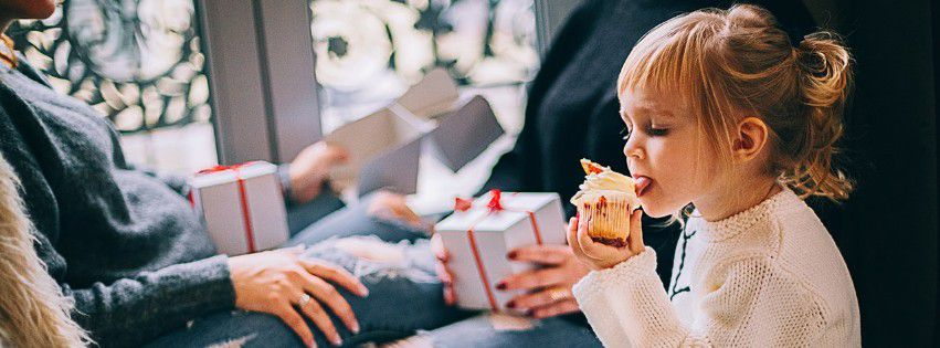 Little Girl Eating Cupcake at Christmas Facebook cover photo