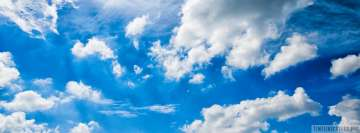 Blue Sky and Puffy Clouds Facebook Wall Image