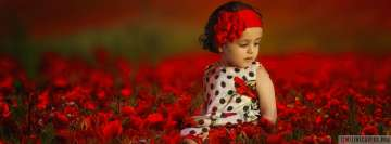 Child Sitting on Red Flower Field Facebook Wall Image