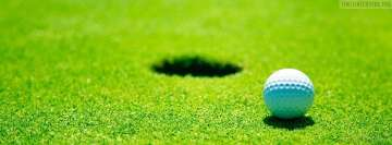 Golf Ball Close to Hole Facebook Wall Image
