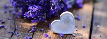 White Hearth on Wooden Table with a Purple Flower