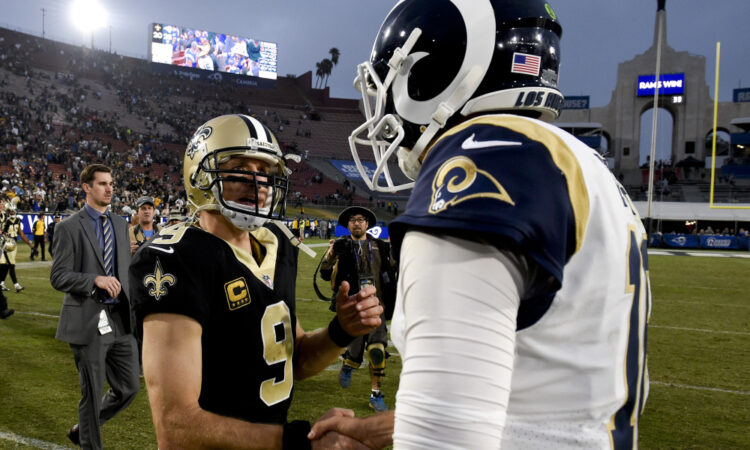 Los Angeles Rams quarterback Jared Goff, right, greets New Orleans Saints quarterback Drew Brees after their 26-20 win during an NFL football game Sunday, Nov. 26, 2017, in Los Angeles. (AP Photo/Kelvin Kuo)