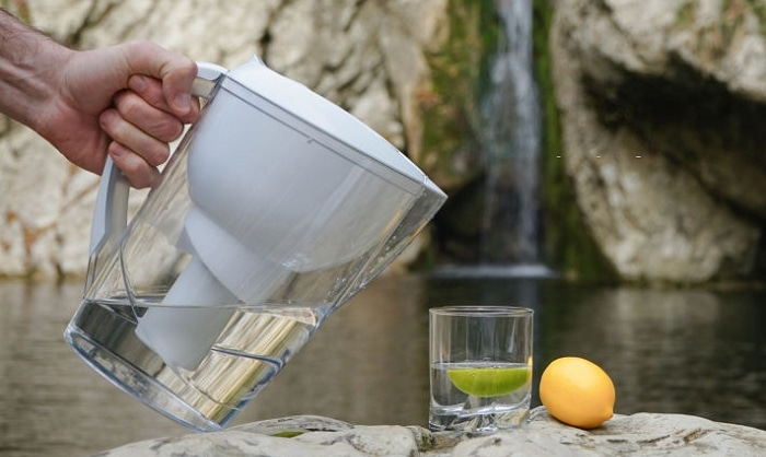 A picture containing person, water, table, food Description automatically generated