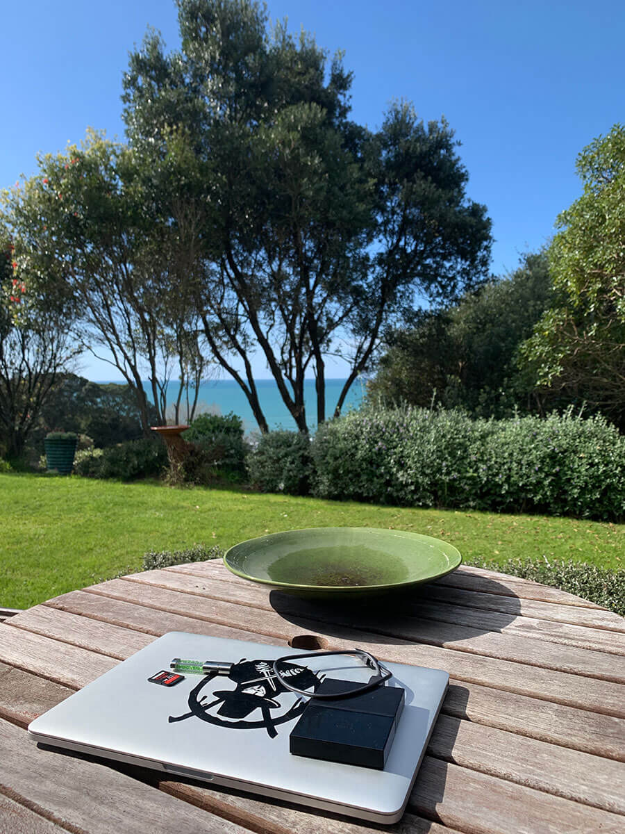 How to travel for free with Workaway - Working from the beach