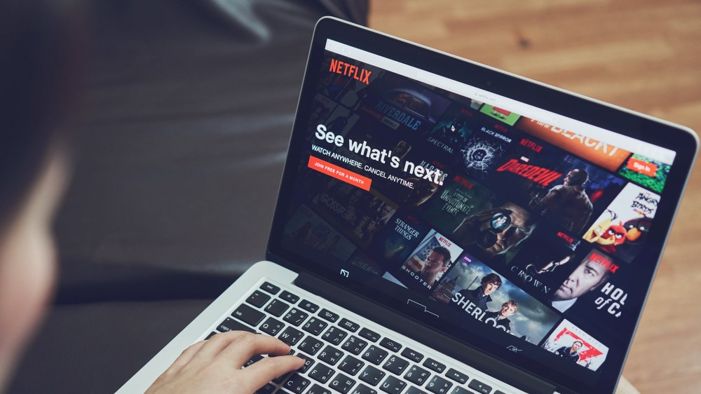 A person looking at Netflix on a Mac