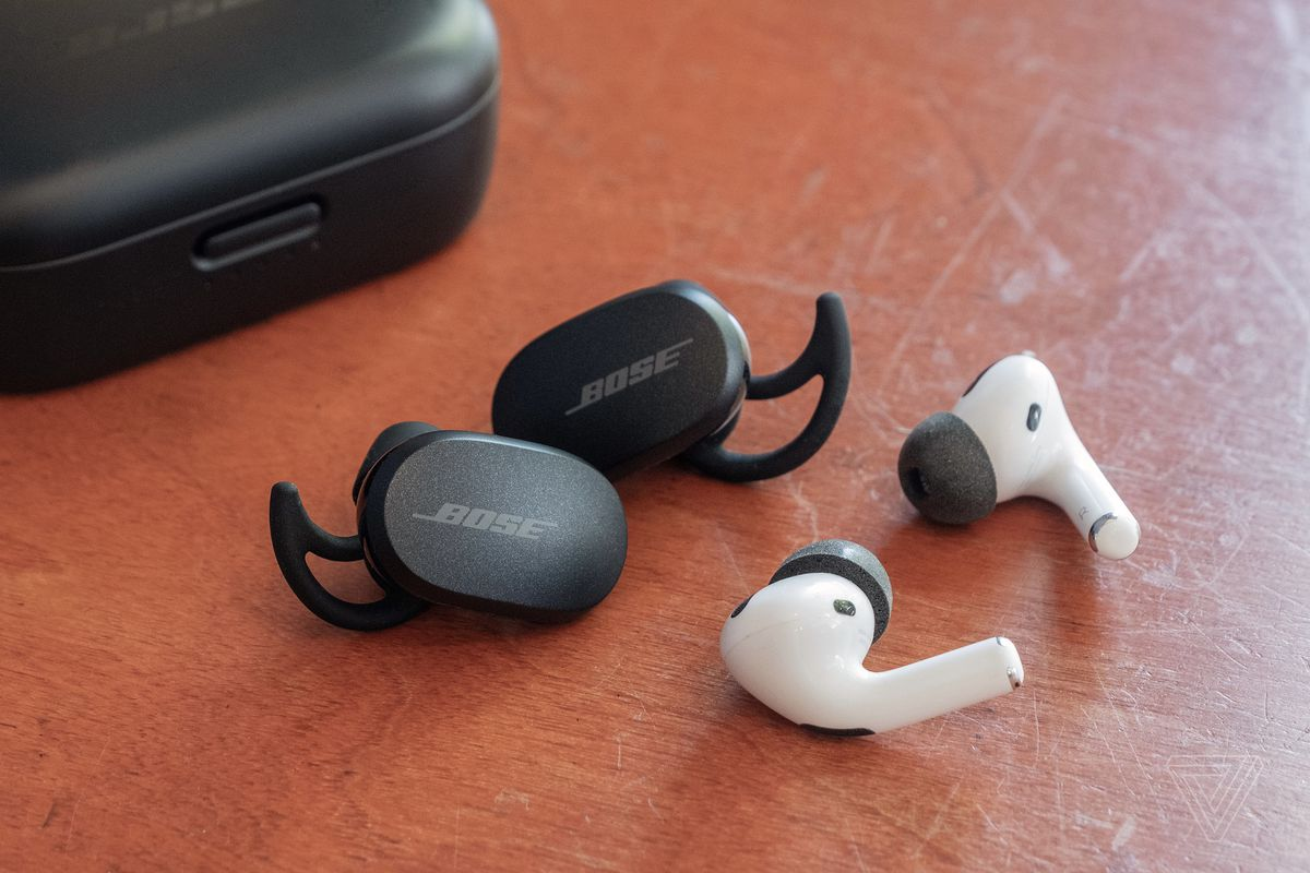 Bose's QuietComfort Earbuds next to the Apple AirPods Pro.