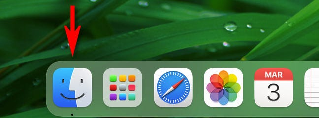"""Click the """"Finder"""" icon in your Dock."""