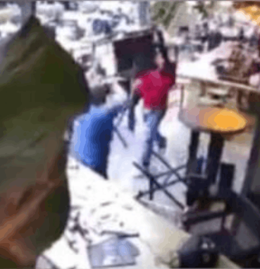 Three men hurling chairs at each other