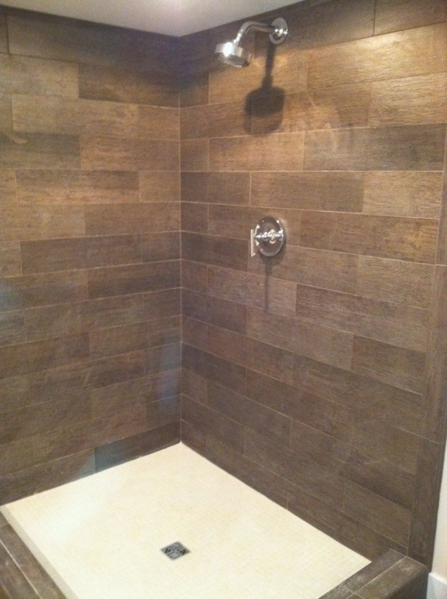 A Lower Level Shower Can Have A Warm Welcoming Feel When intended for Wood Look Tile In Bathroom