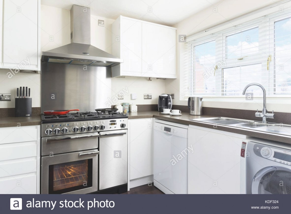 A Small, Clean, Fresh, White Kitchen With Stainless Steel in White And Stainless Steel Kitchen