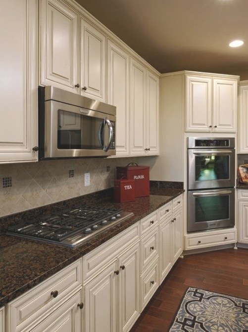 Baltic Brown Granite Counters With White Cabinets for Black And Brown Kitchen
