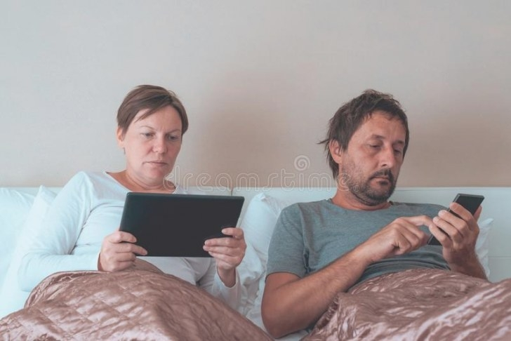 Bored Couple, Husband And Wife In Bedroom Stock Photo with Husband And Wife In Bedroom
