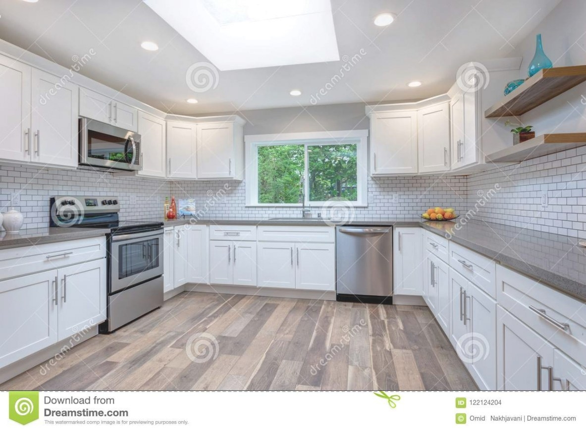 Open Concept Kitchen Equipped With Stainless Steel pertaining to White And Stainless Steel Kitchen