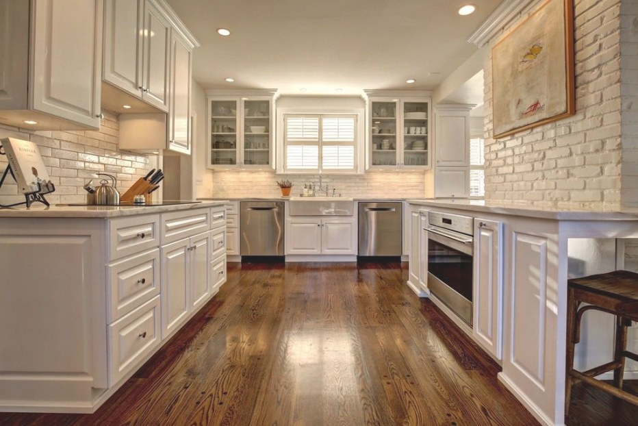 Traditional White Kitchen With Brick Accent Wall. # intended for Accent Walls In Kitchens