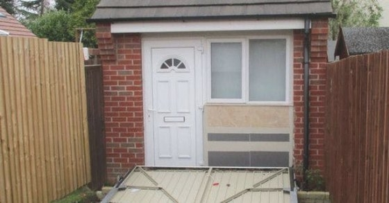 U.k. Couple Used A Fake Garage Door To Hide Illegal Tiny in Is It Illegal To Remodel Without A Permit