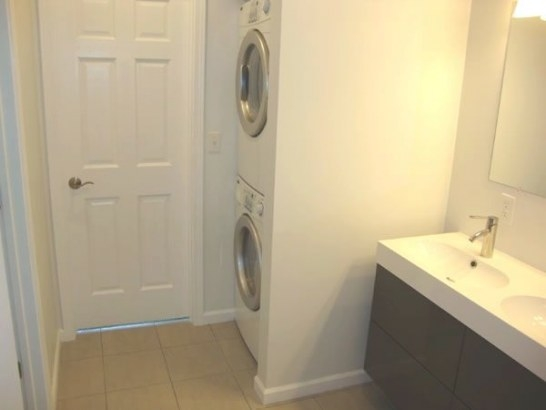 Upper Level Bathroom With Area For Stackable Washer And in Washer Dryer Combo In Bathroom