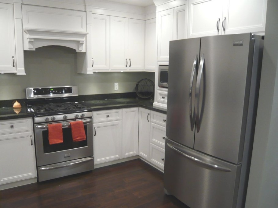 White Cabinets, Black Granite, Dark Hardwood, Stainless for White And Stainless Steel Kitchen