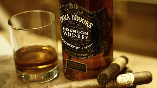 Ezra brooks bourbon bottle with glass and cigar