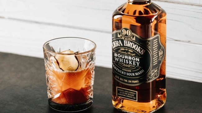 Ezra brooks bourbon bottle with glass and ice