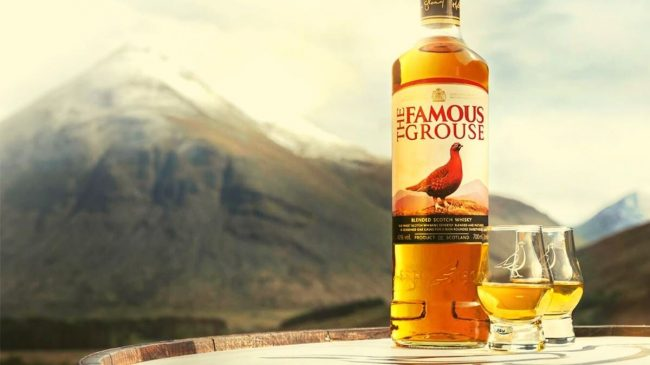 Famous grouse blended scotch whisky bottle and glasses